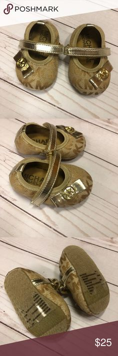 Michaels Kors infant shoes size 1. never worn Adorable gold Michael Kors dress shoes. Size 1 (infant) never worn. Perfect condition. Velcro straps.  💕💕💕 Michael Kors Shoes Baby & Walker