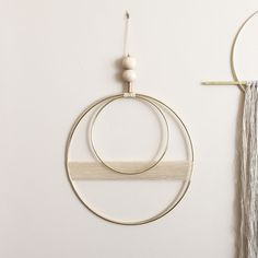 Beautiful brass and waxed cord wall hanging with raw wood and vintage brass bead detail. measurements: larger brass circle is 10' smaller...