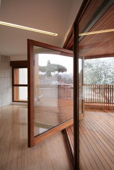 Huge wood framed pivot deck door