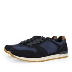 Sneakers de hombre en azul marino. Cierre con cordones. Corte combinado en piel y textil, forro y plantilla en textil. Las zapatillas que nunca pasan de moda.