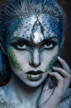 This is my inspiration for my makeup. My element is water and the colour that represents my character is blue. I want her to look like she just came out of the water. I also want her to be glamorous with glitter and patterns on her face to make her feel like a fantasy character