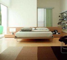 L`autre partie de l`ameublement doit tenir compte de la place qui reste dans la chambre à coucher . L`armoire peut être encastrée , petite ou grande , à deux ailes . En bois ou en matière artificielle , selon vos préférences . Si vous voulez avoir des tiroirs , vous pouvez les commander avec le lit , toujours compte tenu du style d`ameublement de la chambre à coucher . Un fauteuil à bascule pour vous reposer serait une bonne solution .