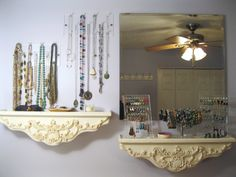 Jewelry Storage for Small Spaces - Acrylic jewelry organizers from The Container Store; Mirror from Ikea; Floating shelves from flea market.