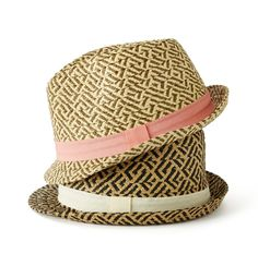 A unique basket weave pattern and vivid band exude a lighthearted vibe on this straw fedora.