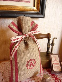 Lovely bag cross stitch monogram. I really like the red on the burlap. Could be diy gift wrapping but I'm.thinking inspiration for larger homemade gifts of burlap.