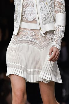 Pleated skirt with sheer detailing.