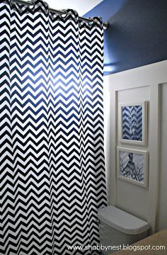 Awesome kids' bathroom makeover at The Shabby Nest. Love navy/white and fun accents.