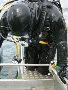 Loitokari drysuit made in Finland, has integral hood, boots and mitts.