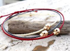 Friendship bracelet, mens bracelet, Skull bracelet - gold skull bead on nylon cord by Beadstheater on Etsy https://www.etsy.com/listing/205322521/friendship-bracelet-mens-bracelet-skull