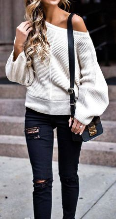 off the shoulder sweater and black distressed denim