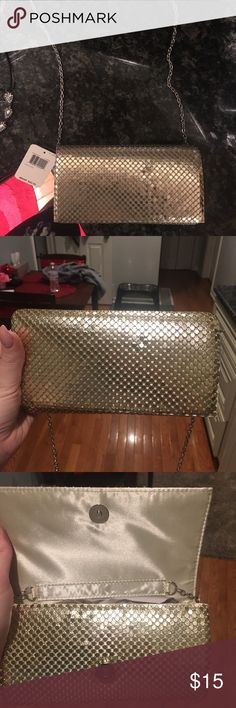 BRAND NEW gold clutch with chain strap Never used (gift from ex boyfriend LOL weirdo left the price tag) but anyway it's an pristine condition and would be cute for a night out! Just not really my style as I like bigger bags and just want it gone! Bags Clutches & Wristlets