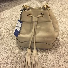 "NWT Rebecca Minkoff Lexi Bucket Bag in Khaki Beautiful quality leather Rebecca Minkoff bag in the classic Lexi Bucket style. Sold out online. Versatile khaki color, goes with any outfit. Beautiful gold hardware chain still under wraps. 9x10x6, 23"" crossbody strap, 12"" if double strapped. Rebecca Minkoff Bags"
