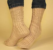 Roger Ackroyd socks by Maureen Foulds. Cables and ribbing in fingering weight yarn.