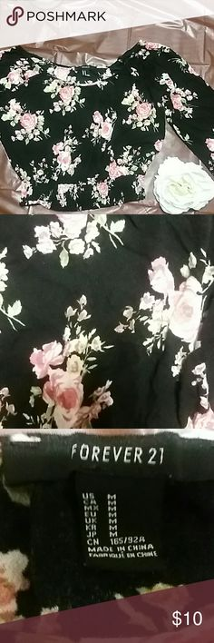 FOREVER21 Floral Long Sleeve Crop top Beautiful black long sleeve crop top from Forever 21 with pink flowers. Great to combine with high waisted shorts. Never worn! Make an offer as I am willing to work with the price ? Forever 21 Tops Tees - Long Sleeve