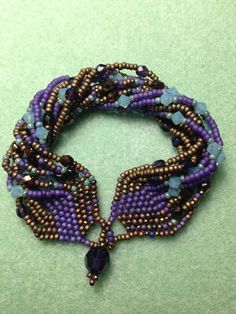 A Brick Stitch and Seed bead Bracelet to go with your Tapestry Earrings and Ring Materials: 11/0 Seed beads Matte Transparent Dark Lilac 11/0 Matte Bronze 11...