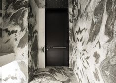 Tuve hotel, a boutique Hong Kong hotel, which Design Systems has lined with flecked marble and textured concrete to create a cold minimal mood