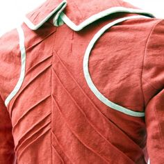 Jacket Gabriel Detail - elaborate pleats and bias trim on what appears to be a linen coat.