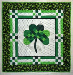 I've finished my Shamrock wallhanging.  The background white fabric is so cute, those little dots are actually tiny shamrocks. These fabri...