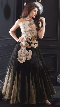 Add an alluring look to your personality. This snazzy black net indowestern gown which is completed with butta, resham and stone work. This readymade gown has maximum bust size of 34 and 36 inches. Product Code  3FD4306364