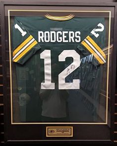 Aaron Rodgers autographed Packers jersey in custom frame JSA