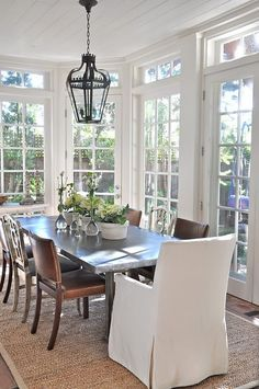 Windows - I love the light and implied space created in this dining room. The doors could open onto a lovely terrace that if done with wonderful lighting could make for a fabulous dinner party.