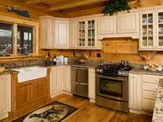 These kitchen cabinets were painted red to complement the tones of the cabin's western red cedar logs. Description from pinterest.com. I searched for this on bing.com/images