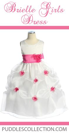 Organza flowers throughout the gathers of the dress