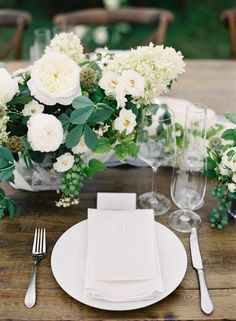 Gorgeous cream white and green table centrepieces. This wedding has long lines of these to give the marquee a feeling of being filled to the brim with beautiful flowers. The wedding arrangement incorporates roses, ivy seed heads and hydrangeas xx