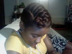 Natural hair style icon Ashley Small with  braided Mohawk-like updo from blackgirllonghair.com --- ooh cute style!