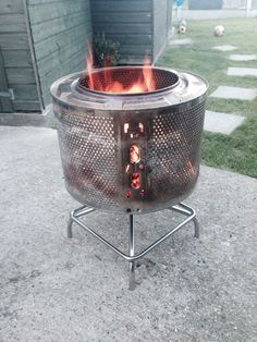 New fire pit washing machine drum and stainless steel stool base.