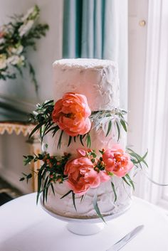 White Frosted Three Tier Wedding Cake with Coral Peony Decor & Green Vines | Peach Colour Scheme | Kelmarsh Hall Country Wedding Venue | Images by Chris Barber Photography | http://www.rockmywedding.co.uk/ellen-ollie/
