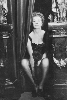 "Leonor Fini, Paris, 1936, photography by Dora Maar. About her art-making process, Fini said: ""I strike it, stalk it, try to make it obey me. Then in its disobedience, it forms things I like."""