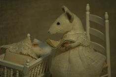 Stuffed Animals by Natasha Fadeeva - mother mouse by the cradle