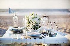 A gorgeous table setting on the beach