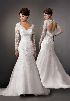 Shown in Diamond White…Dramatic long sleeve fit and flare lace and tulle gown with keyhole back. Beaded band detail. Chapel train.