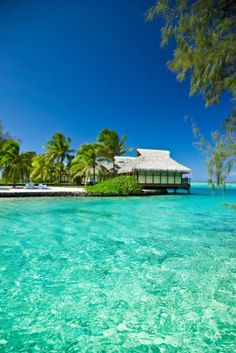 Stay in an over water bungalow in Tahiti...
