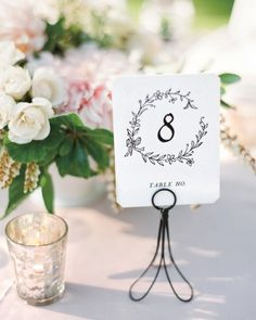 Bhldn table numbers showcased the day's vintage, flower-filled vibe.