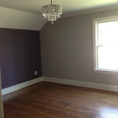 Great Teen Bedroom With Gray / Grey Walls And Plum / Purple Accent Wall.  Check Out The Chandelier With Crystals Hanging Down.