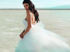 "Kiss of Color: Introducing the ""Aria"" gown by Lauren Elaine Bridal. She's a fairytale-worthy ball gown wedding dress with a flush of customizable ombré color! ""Aria"" features a detachable cathedral train and detachable sleeve accessories on a satin sweetheart bodice . Customize your own color palette with celebrity designer Lauren Elaine.  Unique,  and affordable couture bridal gowns and the ultimate bridal experience! #LaurenElaineBridal"