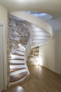 interior spiral staircase design with stone backwall Spiral Stairs Design, Staircase Design, Attic Renovation, Attic Remodel, Under Staircase Ideas, Escalier Design, Wooden Steps, Stair Lighting, Modern Stairs