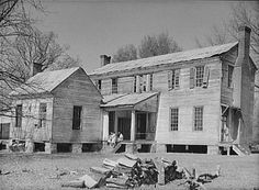 Rear view of the detached kitchen and former plantation home of the Mark Pettway family, called Sandyridge, in Boykin during April 1937. The house was demolished a short time later. Photograph by Arthur Rothstein. Wikipedia