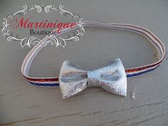 Check out this item in my Etsy shop https://www.etsy.com/listing/233249789/4th-of-july-silver-glitter-bow-on-red