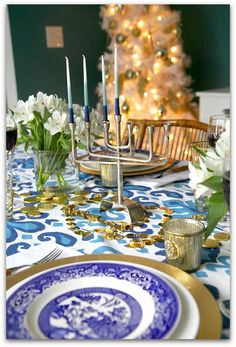 Abby M. Interiors: HOLIDAY SIZZLE 2014: SETTING THE TABLE TO CELEBRATE. Blue and white Hanukkah Table.