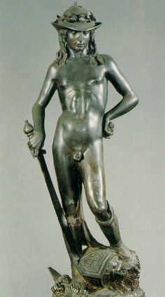 """DONATELLO: David, 1430s, Bronze, h.158 cm, Bargello Museum, Florence. David shows Donatello's elegant handling of Praxiteles's idea of form. Vasari: """"In the courtyard ...stands a bronze statue of David, a nude figure, life-size; having cut off the head of Goliath, David is raising his foot and placing it on him, and he has a sword in his right hand. This figure is so natural in its vivacity and softness that artists find it hardly possible to believe it was not moulded on the living…"""