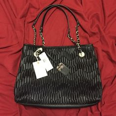 NWT.... Black Jessica Simpson Purse NWT....Black Jessica Simpson Purse. So pretty, bought at Macy's with a few others and never used this one. I forgot I had it three pouch inside with middle zipper, small zipper pocket. Black and brown cheetah print inside. Jessica Simpson Bags