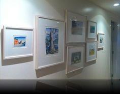 Reg Mombassa art hanging by All Art & Mirrors Installation Services.   http://www.allartandmirrors.com.au/