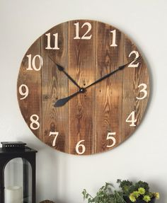 Large wooden wall clock made from pine boards. Wood comes from barn siding that is mildly weathered and still in great condition.  • Made in