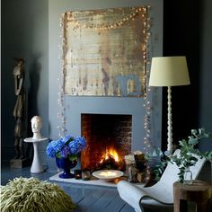 Make clever use of fireplaces by draping a long string of orange fairy lights over your chimney breast.