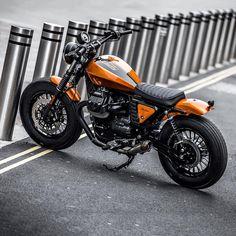 Killer V9 Bobber custom by Moto Strada. Love that hot burnt orange.