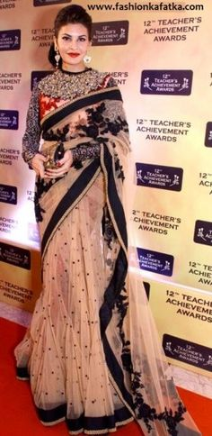 Jacqueline Fernandez style saree at Teachers Achievement Awards 2013 is an exclusive designer #NetSaree, rich with embellishments on net saree blouse and pallu